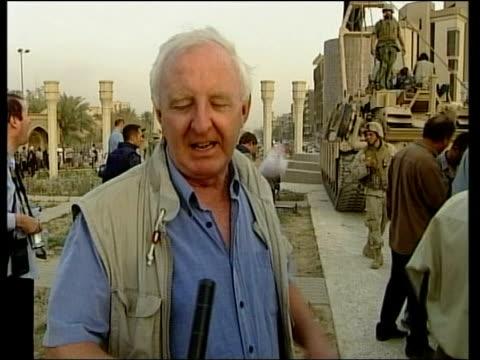 news at nine; news at nine: michael nicholson iraq: baghdad: ext i/c iraqi men standing on plinth of saddam hussein statue vox pops iraqis saddam... - バグダッド点の映像素材/bロール
