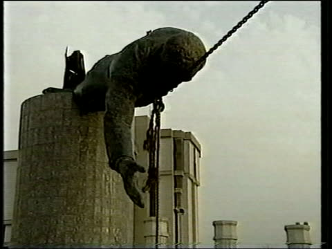 evening news bulletin; iraq: baghdad: ext statue of saddam hussein being pulled down pull out as statue falls to ground pull & tx 10.4.2003/en - saddam hussein stock videos & royalty-free footage