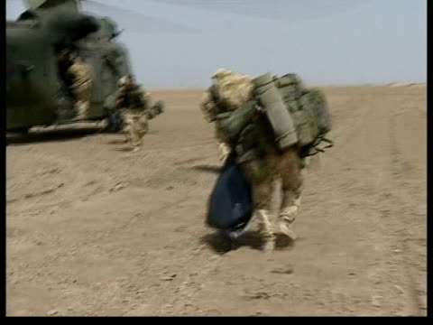 british soldiers return home: anthony crouch; kuwait: ext bv soldiers running towards helicopter - british military stock-videos und b-roll-filmmaterial