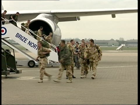 british soldiers return home: anthony crouch; pool england: oxfordshie: raf brize norton: ext gvs british military personnel down steps from plane as... - day26 stock videos & royalty-free footage
