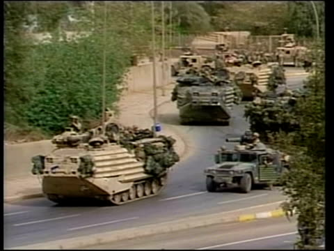 Day 28 Abu Abbas arrest POOL EXT TMS US armoured vehicles on the street PULL TMS US armoured amphibious vehicle crossing central reservation of road...