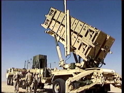 day 4 1300 lunchtime news lib us patriot antiaircraft missile battery radar masts digger driving away towards rocket launcher - luftvärn bildbanksvideor och videomaterial från bakom kulisserna