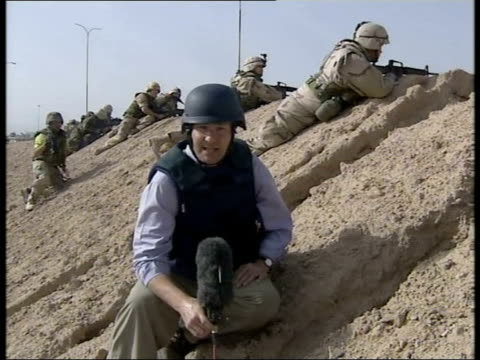day 4 1830 evening news evening news david bowden umm qasr battle iraq umm qasr ext us troops crouching among sand dunes as exchanging fire with... - civilian stock videos & royalty-free footage