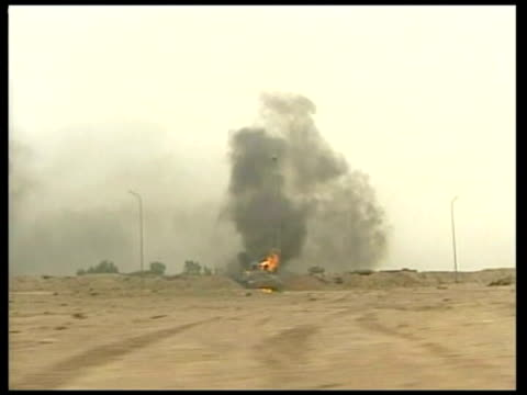 Day 4 1830 Evening news IRAQ Burning tank at roadside TRACK LMS US tank as gunfight underway