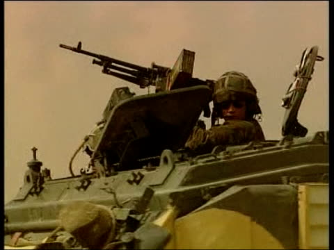 evening news; itn for itv coalition apc driving along cms soldier in front of apc army vehicle towards - itv evening news stock-videos und b-roll-filmmaterial