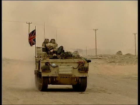 evening news; itn for itv iraq: british army vehicle towards & past bv terry lloyd & camera man daniel demoustier speaking to british soldier - itv evening news stock-videos und b-roll-filmmaterial