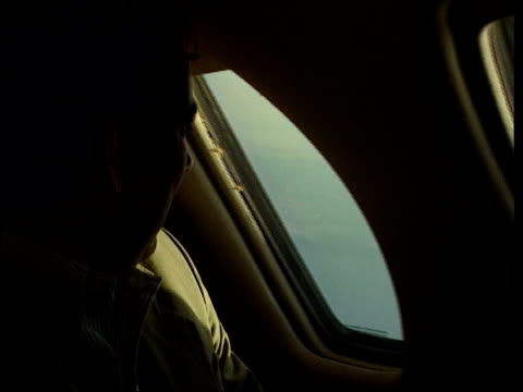 day 4 1830 evening news lib terry lloyd looking out of plane window bv pilots as they spot the balloon in distance - day 1 stock videos and b-roll footage