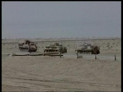 day 4 news at ten 2245 juliet bremner basra / desert rats iraq basra soldiers from the 7th armoured brigade patrolling road around basra airport... - bassora video stock e b–roll