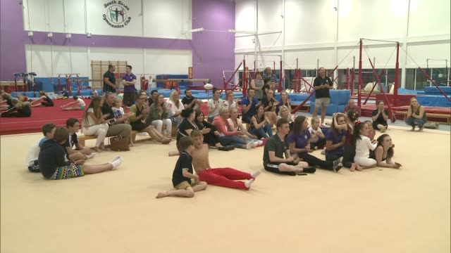 day 4: team gb male gymnasts finish fourth; england: essex: basildon: south essex gymnastics club: people at gymnastics club applauding as watching... - basildon stock videos & royalty-free footage