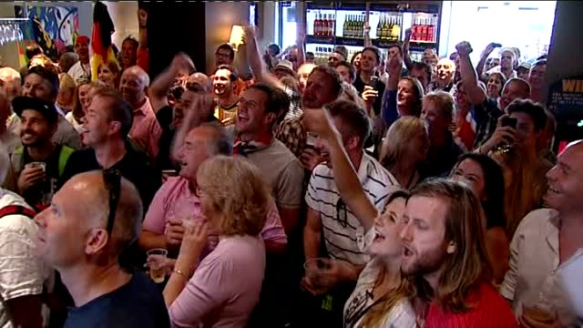 day 5: crowds in bar watching bradley wiggins race; england: london: int general views of crowd in bar watching cycling cheering and chanting... - day 5 stock videos & royalty-free footage