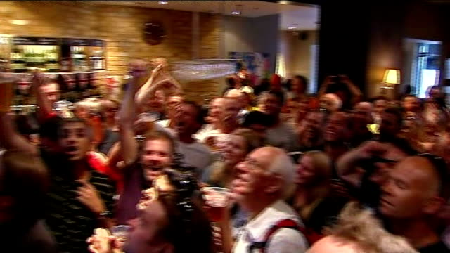 day 5: crowds in bar watching bradley wiggins race; more of crowd cheering and chanting - day 5 stock videos & royalty-free footage
