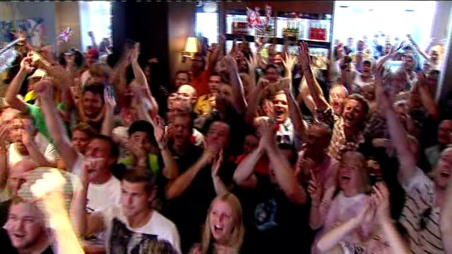day 5: crowds in bar watching bradley wiggins race; more of crowd cheering - day 5 stock videos & royalty-free footage