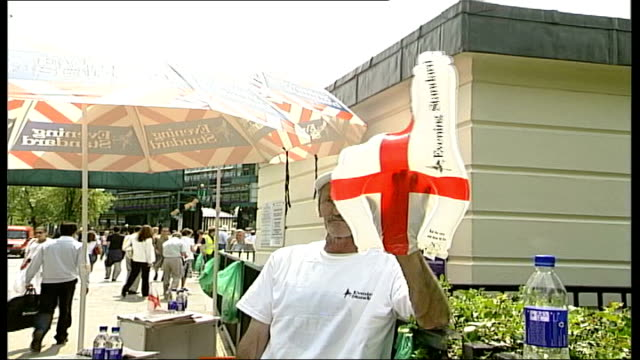 day 5 england london wimbledon all england tennis club ext man selling evening standard inflatable world cup fingers ground to air shot of huge cross... - day 5 stock videos and b-roll footage