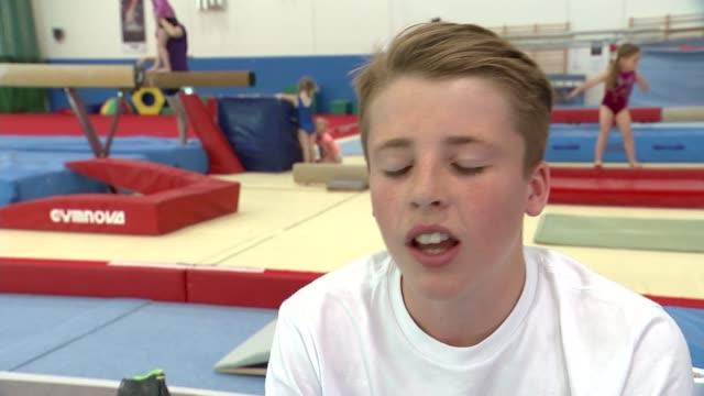 day 6: british sucesses of the day; england: essex: basildon: south essex gymnastics club: int various of boy training on the pommel horse gymnast... - basildon stock-videos und b-roll-filmmaterial