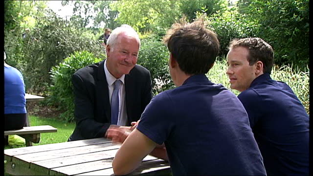 vídeos de stock e filmes b-roll de day 6: men's lightweight four rowers win silver; buckinghamshire: rob williams interview sot various of reporter sitting with james lindsay-fynn and... - lightweight