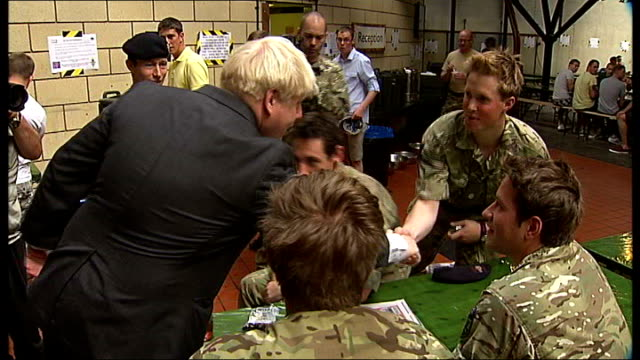 day 7 wapping tabacco dock boris johnson greeting soldiers int johnson shaking hands with soldiers johnson sitting and raising hand in air boris... - rupert murdoch stock videos and b-roll footage
