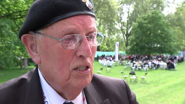 service of remembrance and parade edward bullock interview sot veteran in wheelchair along and aving union jack flags reporter to camera - remembrance day stock videos and b-roll footage