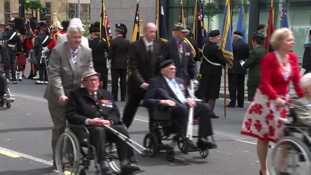 service of remembrance and parade ext **music heard sot** veterans being wheeled along ends - remembrance day stock videos and b-roll footage