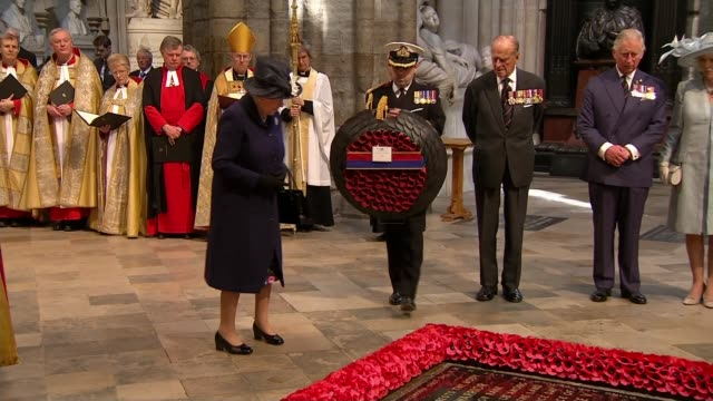 stockvideo's en b-roll-footage met service of remembrance and parade high angle shot of westminster abbey as bells heard tolling natsot int queen elizabeth ii laying wreath at the tomb... - westminster abbey