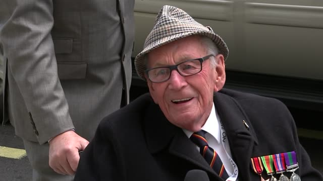 service of remembrance and parade thomas and wife vera in wheelchairs vera laughing thomas interview sot vera interview sot vox pops legs of soldiers... - remembrance day stock videos and b-roll footage