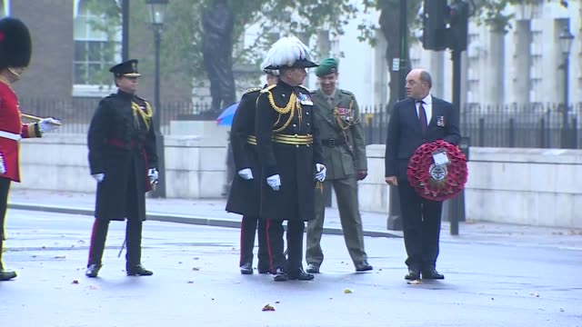 ben wallace lays wreath at the cenotaph; england: london: westminster: whitehall: ext troops along an otherwise empty whitehall / ben wallace mp... - ben wallace stock videos & royalty-free footage