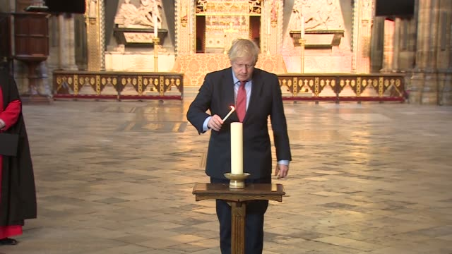 boris johnson visits westminster abbey; england: london: westminster abbey: int boris johnson mp along with dr david hoyle / johnson lighting candle... - tomb of the unknown warrior westminster abbey stock videos & royalty-free footage
