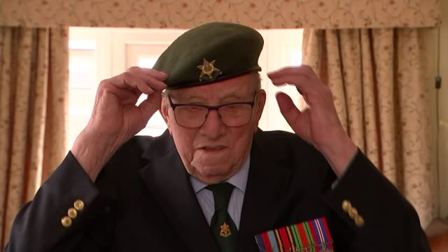 interview with veteran sergeant jim posnett england leicestershire melton mowbray int gv bowl of sweets on coffee table and blazer bearing insignia... - cap stock videos & royalty-free footage