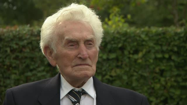royal family lead commemorations; england: staffordshire: alrewas: national memorial arboretum: ext veteran pushed along in wheelchair veterans along... - vj演出点の映像素材/bロール
