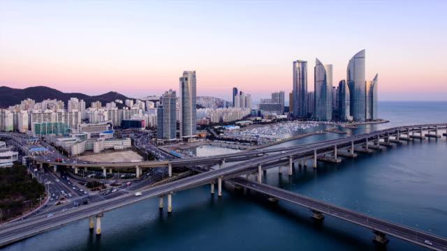 day and night of gwangandaegyo bridge traffic and marine city / haeundae-gu, busan, south korea - busan stock videos & royalty-free footage