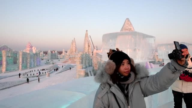 A day before the annual Harbin Ice and Snow Sculpture Festival in China begins people visit the Harbin Ice and Snow World in the chilly northeastern...