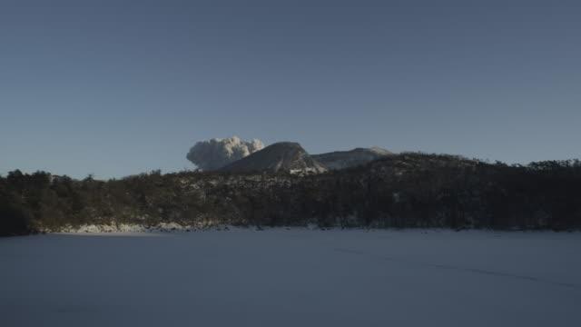 Day, blue sky, smoke billows from top of volcano, Kirishima, Japan, February 2011