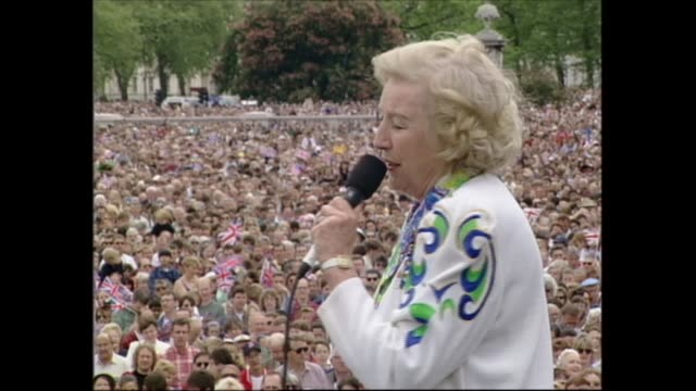 buckingham palace celebrations; england: london: buckingham palace: vera lynn begins 'nightingales sang in berkley square'; c/aways crowd; tcms crowd... - harry secombe stock videos & royalty-free footage