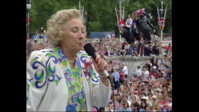 buckingham palace celebrations; england: london: buckingham palace: cms royals on balcony as listen to vera lynn begin 'the white cliffs of dover';... - harry secombe stock videos & royalty-free footage