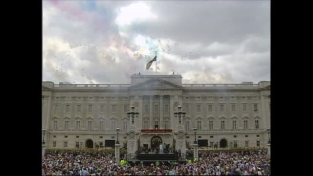 buckingham palace celebrations; england: london: buckingham palace: air/a red arrows in flight over city g/air red arrows over palace; gv palace as... - harry secombe stock videos & royalty-free footage