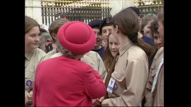 buckingham palace celebrations england london buckingham palace cms queen smiling as chats with girl guides and scouts various shots ditto queen... - queen dowager stock videos & royalty-free footage