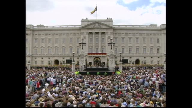 buckingham palace celebrations; england: london: buckingham palace: cliff richard with bob holness and harry secombe as chat with crowd; richards... - harry secombe stock videos & royalty-free footage