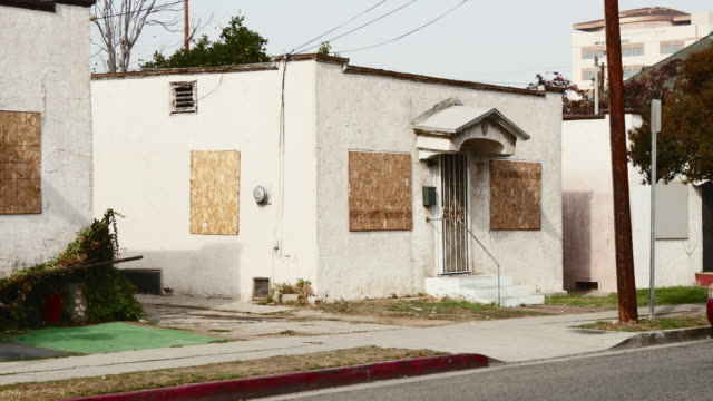 Day Exterior Boarded Up Single Family Apartments
