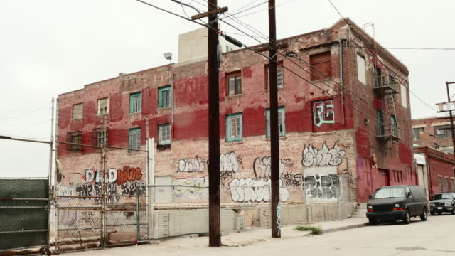 day exterior decaying brick warehouse with graffiti - run down stock videos & royalty-free footage