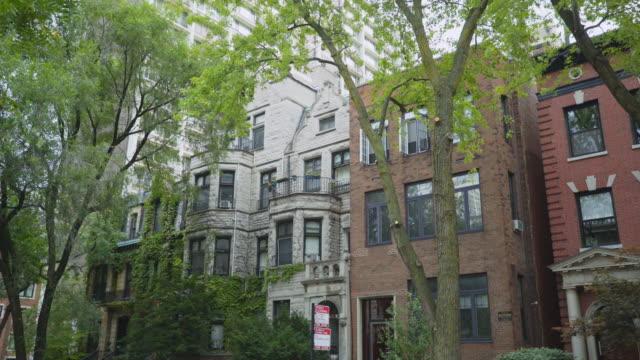 day exterior row of luxury apartments - テラスハウス点の映像素材/bロール