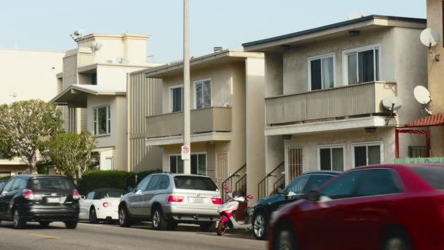 day exterior row of two story apartments - flat stock videos & royalty-free footage