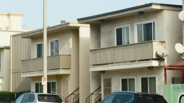 day exterior row of two story apartments - venice california stock videos & royalty-free footage
