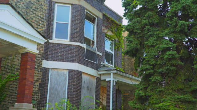 day exterior run down boarded up apartment - run down stock videos and b-roll footage