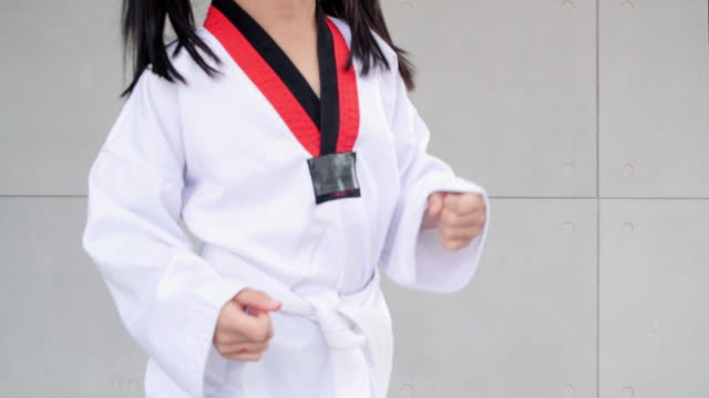 day in the life of a child : little asian child in fighting action,asian girl practice taekwondo,asian taekwondo girl - belt stock videos & royalty-free footage