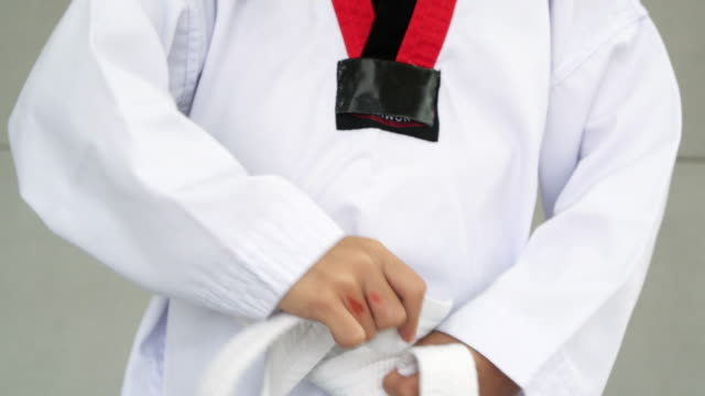 Day in the Life of a Child : Little asian child in fighting action,Asian girl practice taekwondo,Asian taekwondo girl