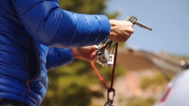 a day in the life of a climbing couple: preparing the equipment - climbing equipment stock videos & royalty-free footage