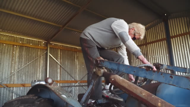 a day in the life of a farming family: granny and the tractor - 65 69 years stock videos & royalty-free footage