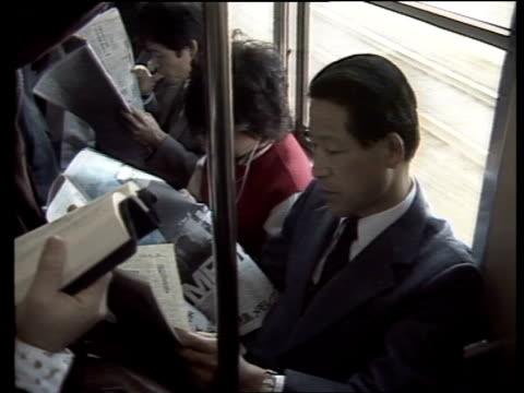 day in the life of a japanese worker; japan: tokyo 6am: hiroshi ichikawa and family have breakfast as they watch breakfast tv hiroshi leaving home... - showa period stock videos & royalty-free footage