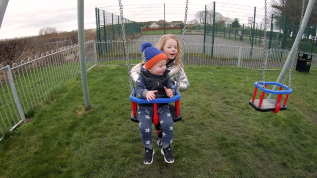 day in the playground - swinging stock videos & royalty-free footage