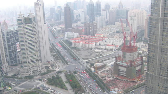 T/L WS Day into night view of traffic and construction / Shanghai, China
