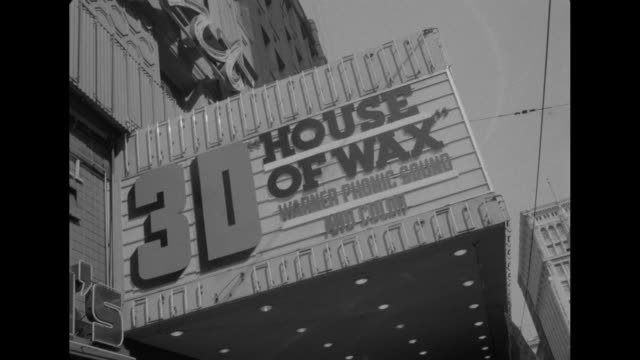 left end of paramount theatre marquee not lit touting the showing of the 3d 'house of wax' in 'warner phonic sound and color' / interior of theater... - wax stock videos & royalty-free footage